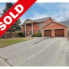 SOLD -  CUSTOM BUILT HOME BACKING ONTO NATURAL FOREST